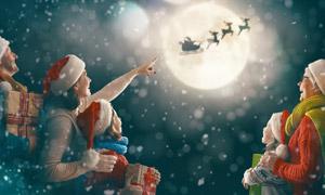 圣诞老人剪影与幸福一家人高清图片