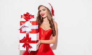 抱着一摞礼物盒的美女摄影高清图片