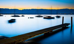 黄昏下的海边码头美景摄影图片