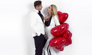 西装打扮的情人节男女摄影高清图片