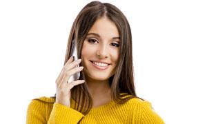 在撥打電話的美女人物攝影高清圖片