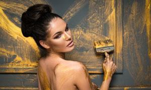 在涂抹金粉的盤頭美女攝影高清圖片