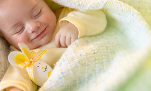 做著美夢的可愛小寶寶攝影高清圖片