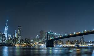 城市大橋與建筑群夜景攝影高清圖片