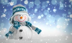 戴帽子圍巾的可愛雪人攝影高清圖片