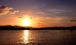 夕阳下的美丽西湖高清摄影图片