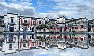 池塘倒影中的宏村美景摄影图片