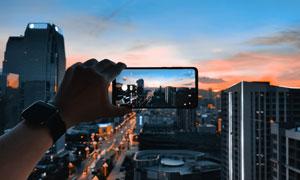 黃昏時城市美景盡收于手機高清圖片