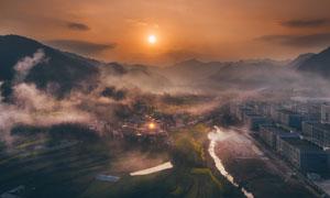 盆地地貌山峦与建筑物摄影高清图片