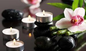 蜡烛花朵与砭石等特写摄影高清图片