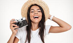 头戴着一顶草帽的美女摄影高清图片