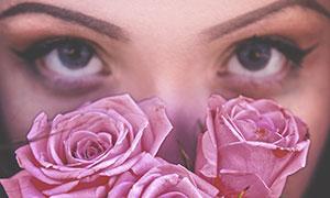 玫瑰花后面的妆容美女摄影高清图片