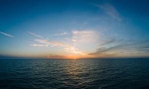 海洋中的日落美景高清摄影图片