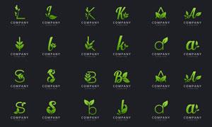 绿叶点缀英文字母创意标志矢量素材