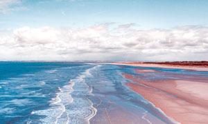 海浪打击沙滩景观摄影图片