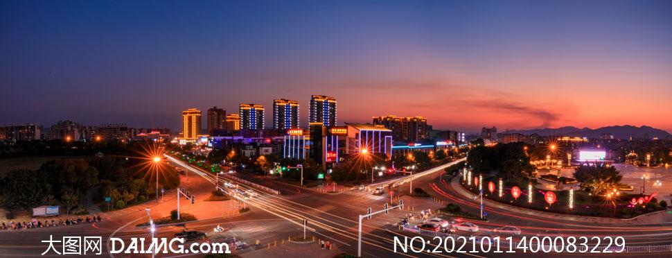 夜幕降临下的城市建筑摄影图片