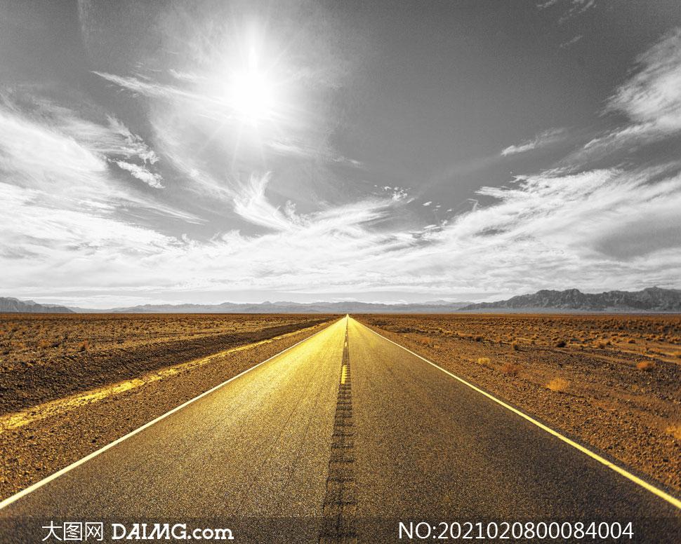阳光下的金色公路摄影图片