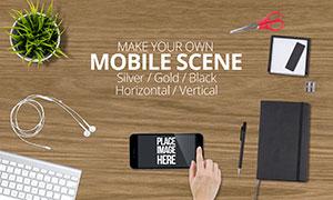 桌面上的手机与记事本等样机源文件