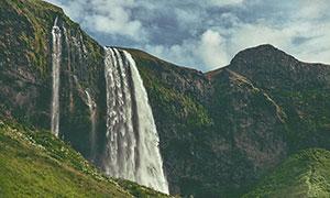 懸崖上的瀑布景觀攝影圖片