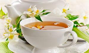 茶壶鲜花与茶杯等特写摄影高清图片