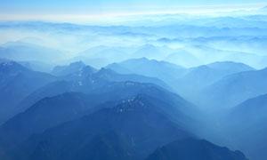 藍色唯美的群山云霧景觀攝影圖片