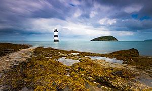 大海中的岛屿与灯塔等摄影高清图片