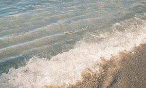 海边沙滩浪花自然风景鸟瞰摄影图片